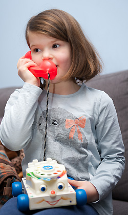 A child with a toy telephone